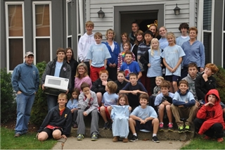 Fenn students standing in front of house