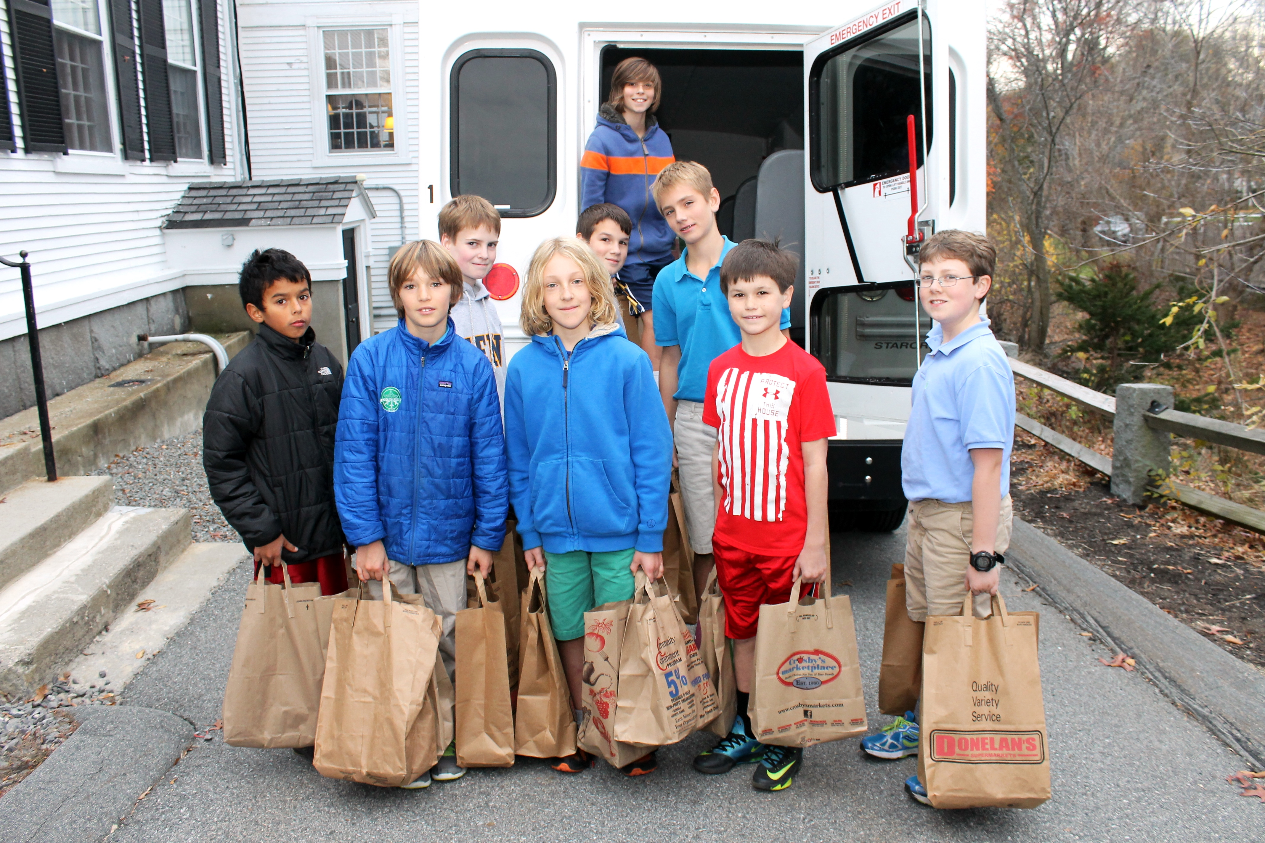 Fenn students holding grocery bags